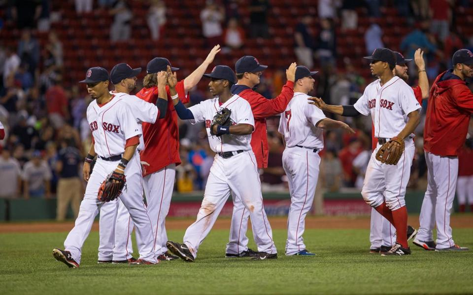 BOSTON, MA - JULY 26: The Boston Red Sox celebrate a 11-1 victory against the Detroit Tigers at Fenway Park on July 26, 2015 in Boston, Massachusetts. (Photo by Rich Gagnon/Getty Images)