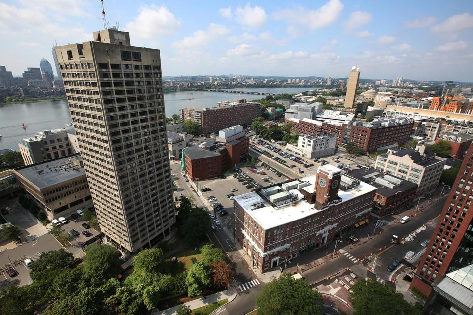 MIT's plans for Kendall Square include demoltion of the Eastgate tower (at left) and construction of housing, office, research, and retail space on the site and adjacent lots along and behind Main Street.