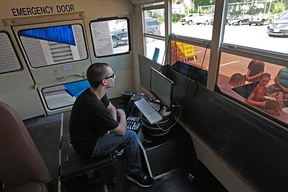 Bryce Quinn, of The Record Company, inside the bus, monitored the audio.