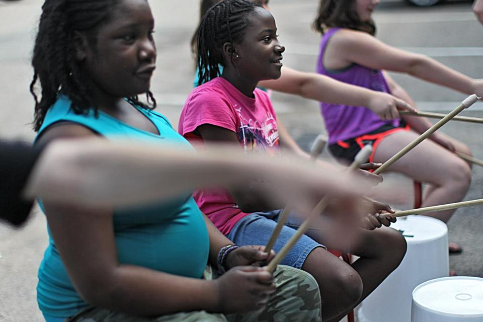 Brianna Charles, 9, in pink, and Kaisha Toombs-Porcher, in blue, played the drums.