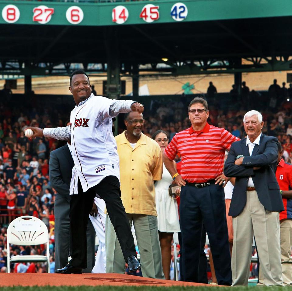Pedro Martinez threw out the first pitch Tuesday with fellow Red Sox Hall of Famers Jim Rice, Carlton Fisk, and Carl Yastrzemski — and his newly retired No. 45 — behind him.
