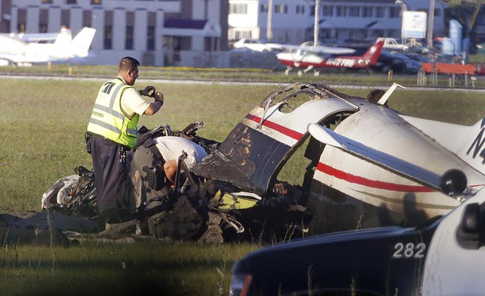Investigators looked through the wreckage of Joseph F. Trustey's Socata TBM-700, which crashed at Lawrence J. Timmerman Airport in Milwaukee.