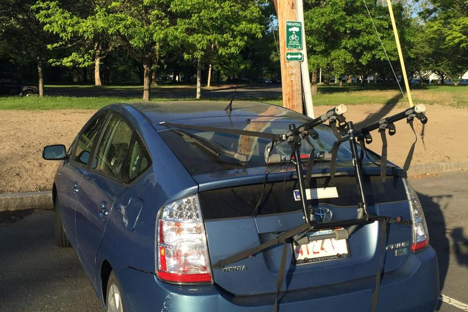 A car parked in one of the bike spots along Soldiers Field Road in Brighton.