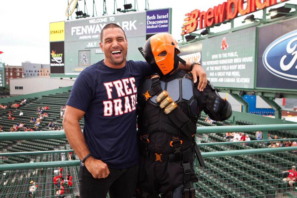 Actor Manu Bennett (left) met his character Deathstroke, played by Brian Anderson, at the Boston Comic Con Night at Fenway Park on Thursday.