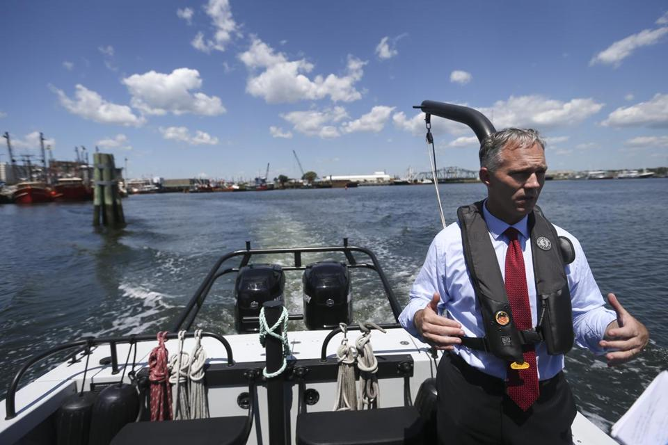 "Mayor Jon Mitchell of New Bedford rode on the harbor master's boat. ""We're continuing to hit the singles and doubles of economic development. There isn't anything sexy about those types of efforts,"" he says."