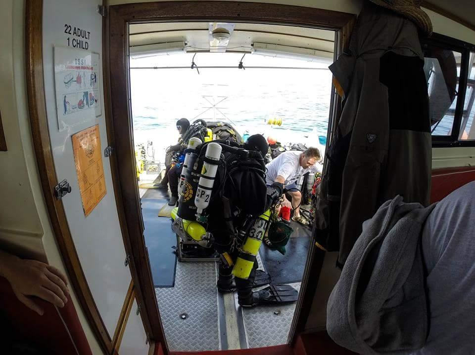 Tom Pritchard (center) prepared for a dive down to the Andrea Doria wreck on board the John Jack on July 21. Pritchard never surfaced, and his body has not been recovered.