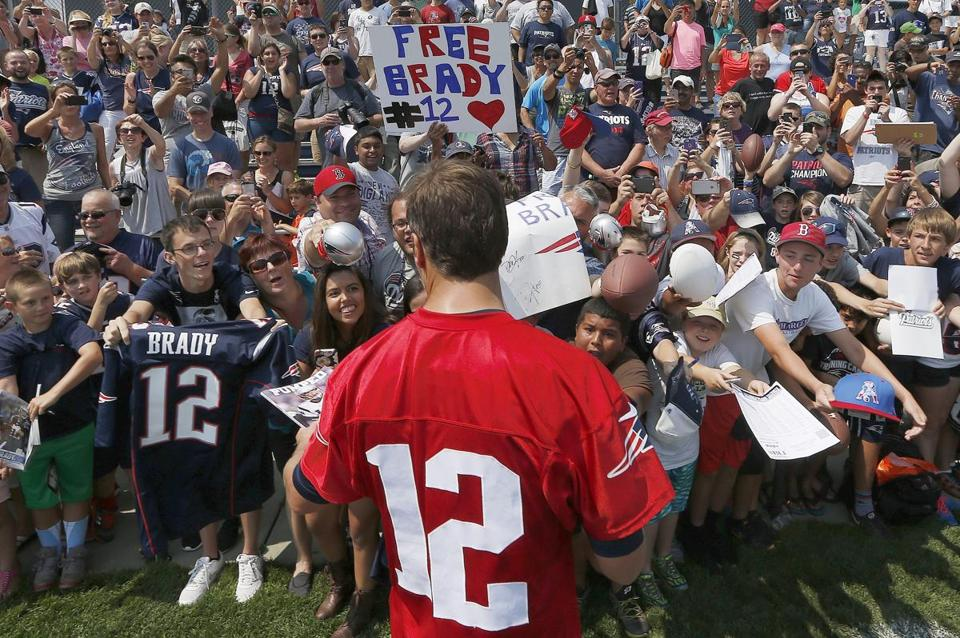 Tom Brady signed autographs during training camp in Foxborough Saturday.