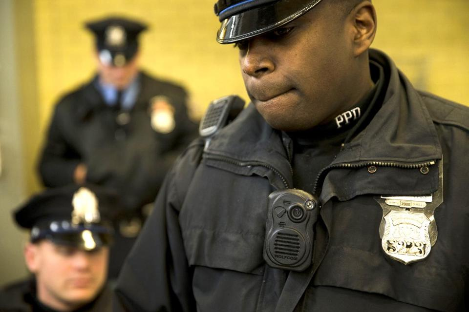 Philadelphia police officers demonstrated a body-worn camera as part of a pilot program.