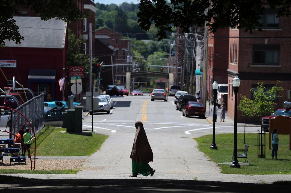 A Somali woman passed through Kennedy Park in Lewiston, Maine earlier this month.