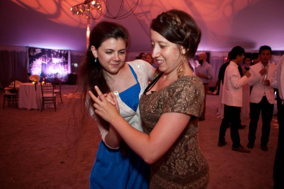 "Lenox, MA -- 08/08/15 -- Lucy Fitz Gibbon (left) and Zoe Madonna danced at the Tanglewood Gala party on August 8, 2015, in Lenox, Massachusetts. The Tanglewood Music Center celebrated it's 75th anniversary with a gala, and performance of Mahler's Symphony No 8, ""Symphony of a Thousand,"" conducted by BSO Music Director Andris Nelsons. (Kayana Szymczak for the Boston Globe)"