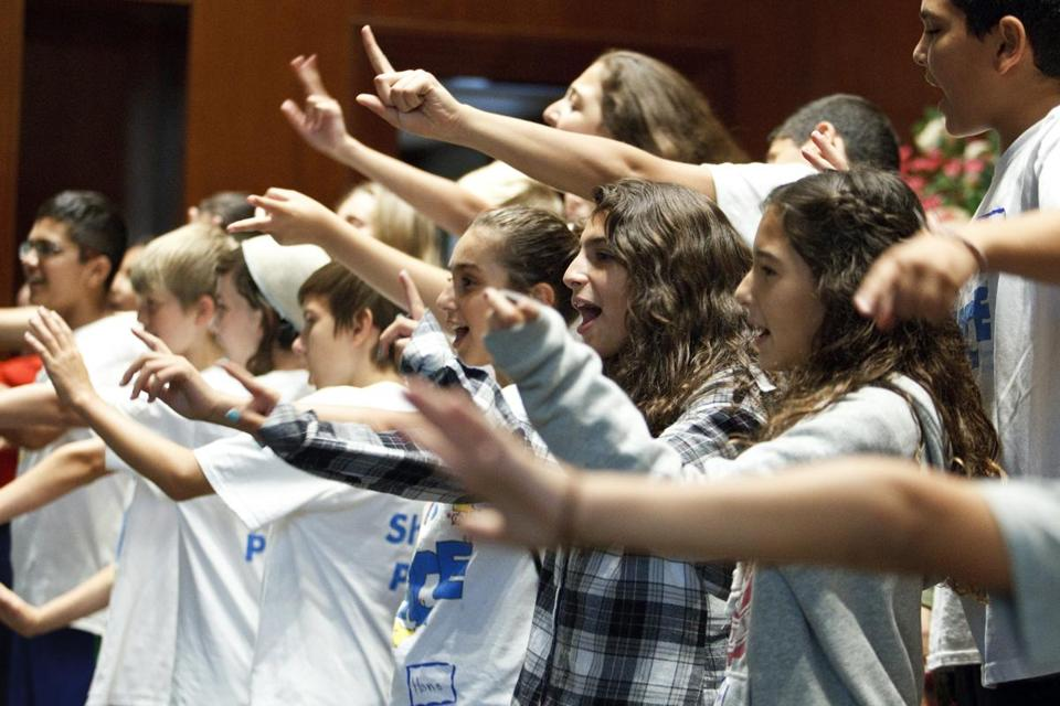 Boys and girls performed on Sunday at Temple Beth Zion in Brookline as the Kids4Peace summer camp came to an end.