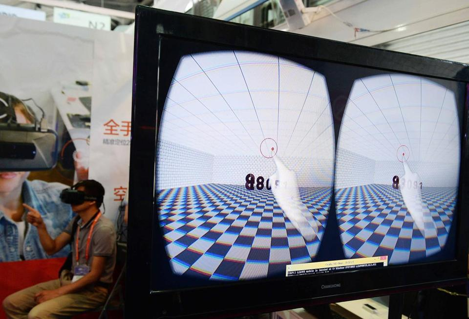 A visitor tested the Oculus Rift at a consumer electronics show in Shanghai in May.