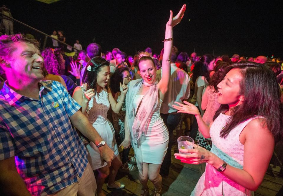 08/07/2015 BOSTON, MA L-R Jeff Rains (cq), Kristina Liu (cq), Valerie Carlberg (cq) and Marilyn Liang (cq) dance during a White Party at the ICA in Boston. (Aram Boghosian for The Boston Globe)