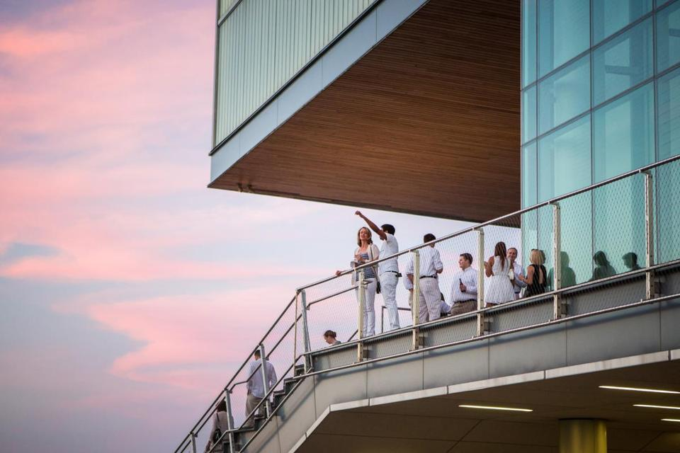 08/07/2015 BOSTON, MA Attendees watched the sunset during a White Party at the ICA in Boston. (Aram Boghosian for The Boston Globe)