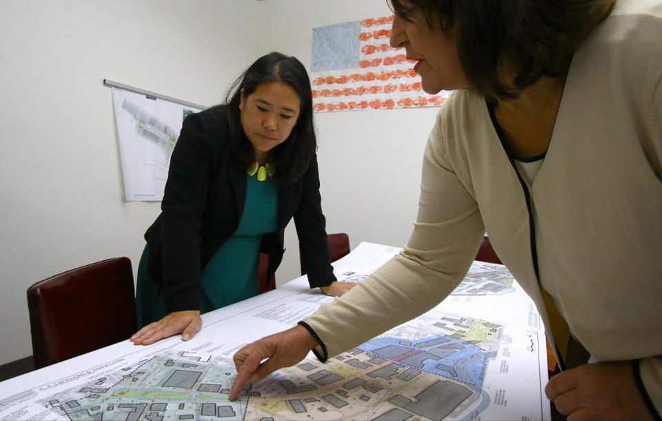 Economic development director, Mary Jo Bohart, (right) and Fitchburg Mayor Lisa Wong, went over city planning prints.