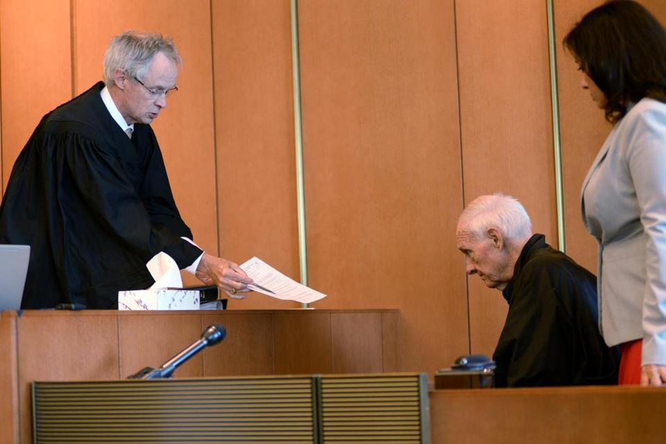 Judge Timothy Feeley addresses former Rev. Richard McCormick, 74 in Salem Superior Court in Boston, Monday, Aug. 10, 2015. The retired Roman Catholic priest imprisoned for child rape has been sentenced to 8 to 10 years behind bars for assaulting another boy at a Massachusetts summer camp in the 1980s. (Faith Ninivaggi/The Boston Herald via AP, Pool)
