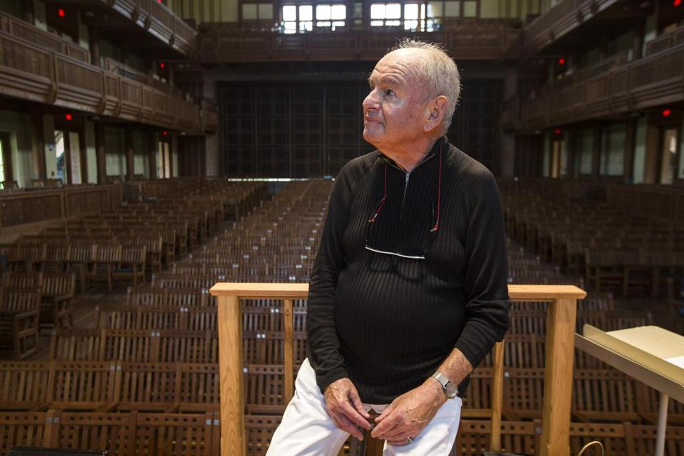Lenox, Massachusetts - 8/11/2015 - John Oliver, founding director of the Tanglewood Chorus, sits on stage after leading the chorus during a rehearsal at the Seiji Ozawa Hall in Lenox, Massachusetts, August 11, 2015. (Keith Bedford/Globe Staff)