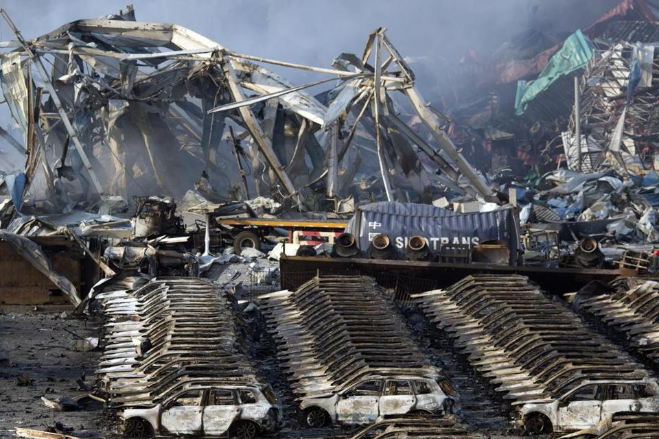 9f6953dcbed Charred remains of a warehouse and new cars were left burned after an  explosion in northeastern