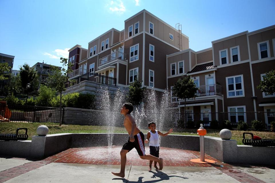 Children played in a fountain in the Box District, a newly redeveloped area near Bellingham Square in Chelsea.