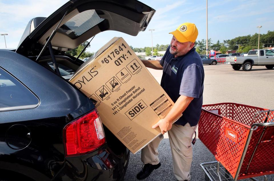 Carl Judson of Kingston loaded a chest freezer into his vehicle at Lowe's in Pembroke on Saturday morning. Judson said he saved about $30 on the purchase.