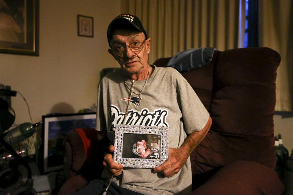 David Coxon, 69, held a picture of his daughter, Jessica, and granddaughter, Ava, in his Marlborough home.