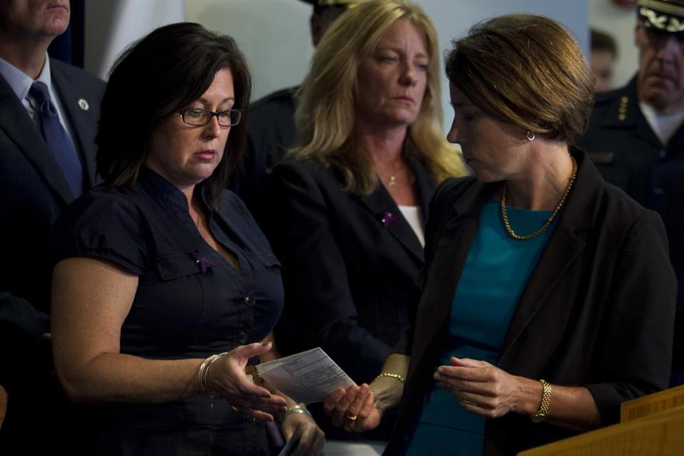 Attorney General Maura Healey (right) handed Cathy Fennelly, whose son, Paul, fatally overdosed from fentanyl-laced heroin, his death certificate.