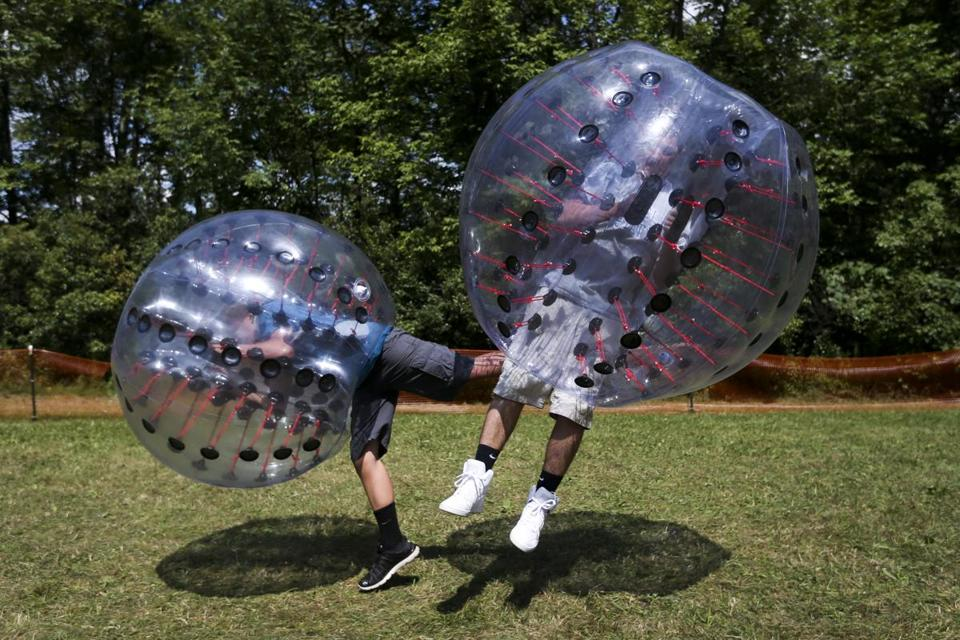 Players collide in a Knockerball game at the recent Bolton Fair.