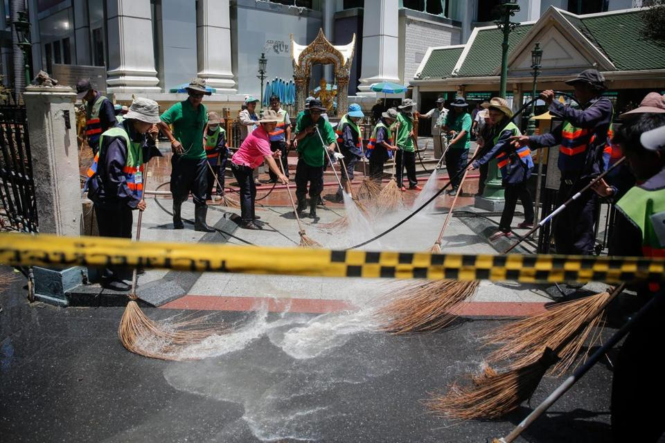 Police worked at the scene of Monday's bombing in Bangkok.