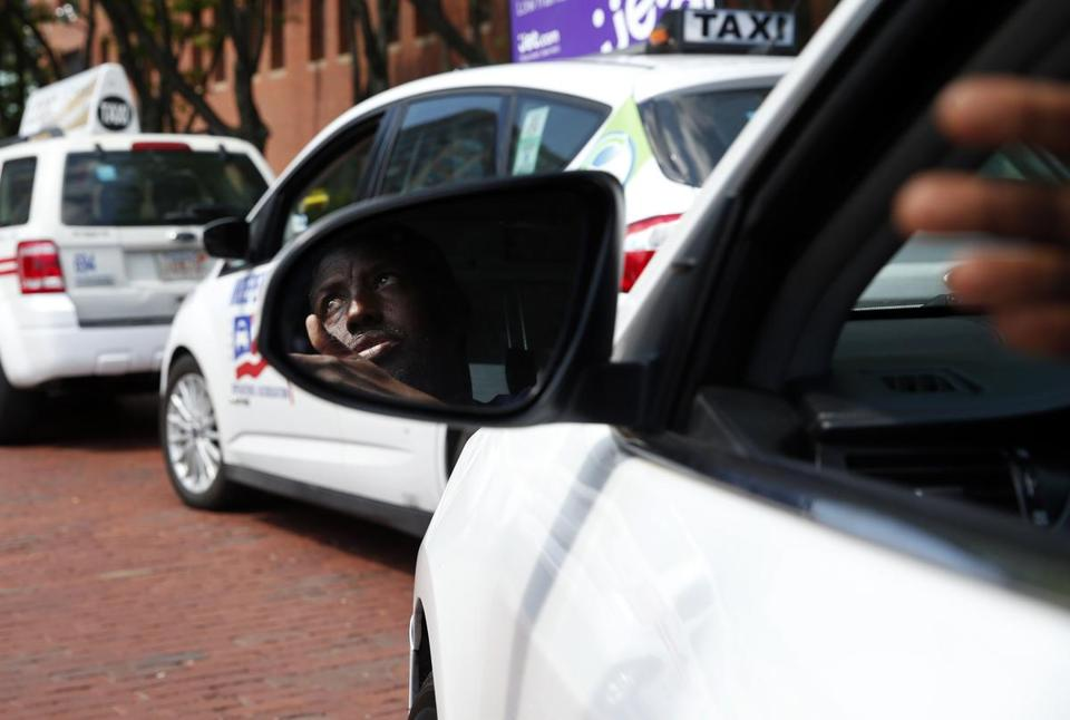 Taxi driver Daniel Ali, 52, of Jamaica Plain, waited in line to pick up a fare outside of the Marriott near the Aquarium in Boston on Wednesday.