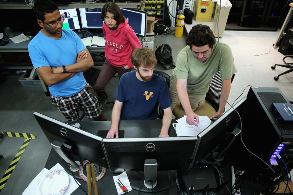 BLACKSBURG, VA - MAY 27: Virginia Tech mechanical engineering students (L-R) Lakshitha Dantanarayana, Chris Nogales, James Burton and James Paterson work all night to test the ESCHER robot the TREC (Terrestrial Robotics Engineering and Controls) Lab May 27, 2015 in Blacksburg, Virginia. Unlike many of the other 24 international teams competing in the Defense Advanced Research Projects Agency (DARPA) Robotics Challenge, the students of Team Valor have built most of the semi-autonomous ESCHER (Electromechanical Series Compliant Humanoid for Emergency Response) robot from the ground up over the last three months. The winner of the simulated disaster-response course will take home a $2 million prize next week in Pomona, California. (Photo by Chip Somodevilla/Getty Images)