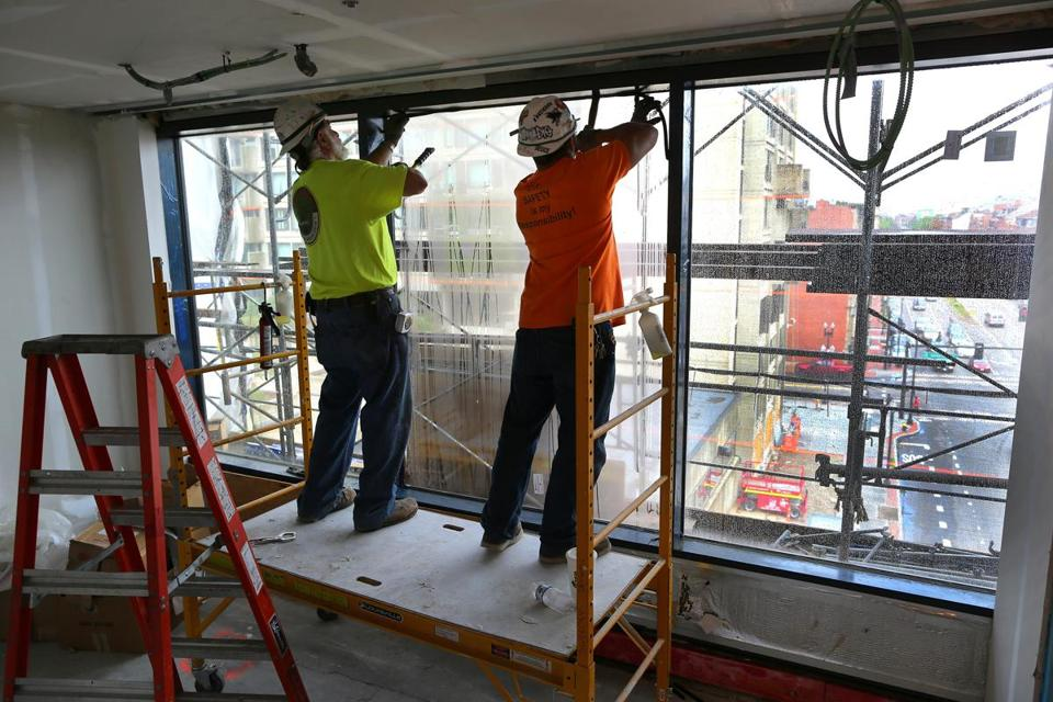 Workers installed energy efficient windows inside Boston Medical Center's new maternity ward.