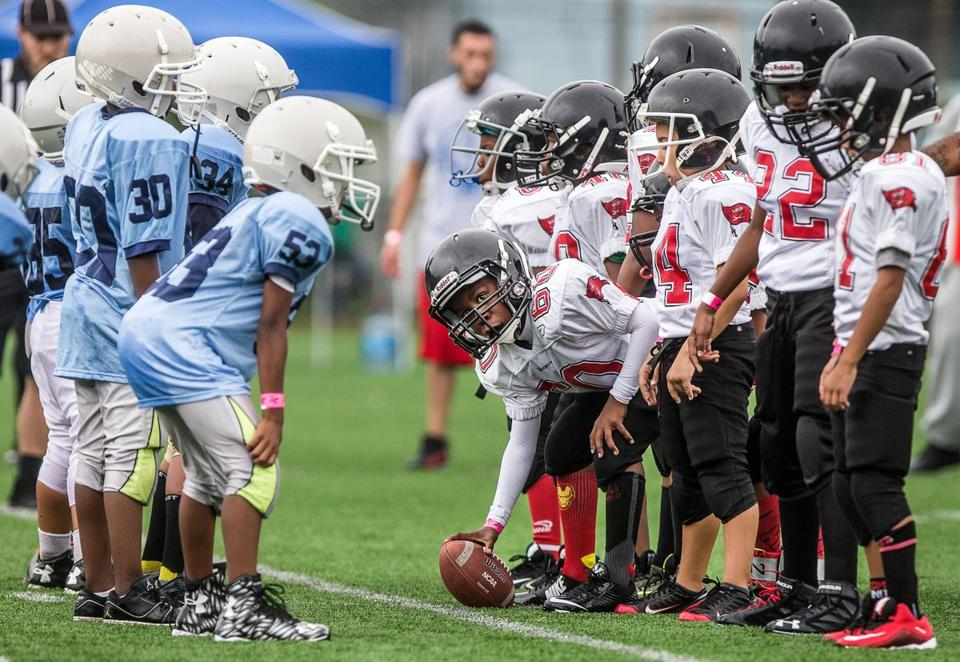 08/23/2015 DORCHESTER, MA The South End Titans (left) square off against the Mission Hill Buccaneers during the Mayor's Cup Pop Warner Football Jamboree held at Roberts Playground in Dorchester. (Aram Boghosian for The Boston Globe)