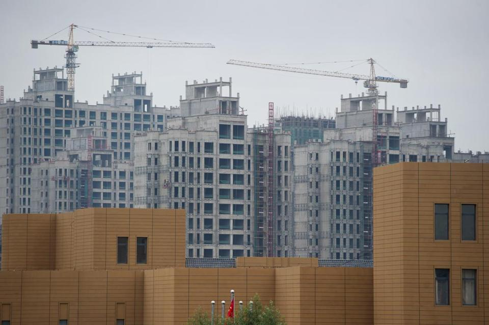 "A 2012 photo shows construction in Ordos. A building boom triggered a frenzy of building in the city, but the local government struggled to fill the towers and Ordos was named a ""ghost city."""