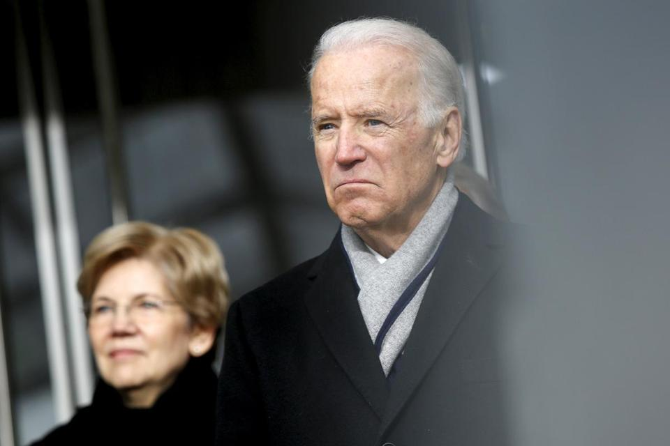 Senator Elizabeth Warren and VIce President Joe Biden listened to remarks at the dedication ceremony for the Edward M. Kennedy Institute for the United States Senate on March 30.