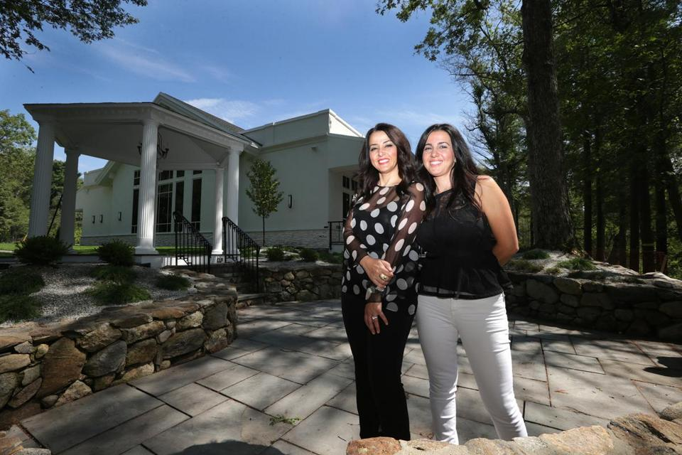Natalia Kapourelakos (left) and Anastasia Tsoumbanos at the rebuilt Lakeview Pavilion in Foxborough. A fire in 2014 razed the function hall the sisters owned at the same site.