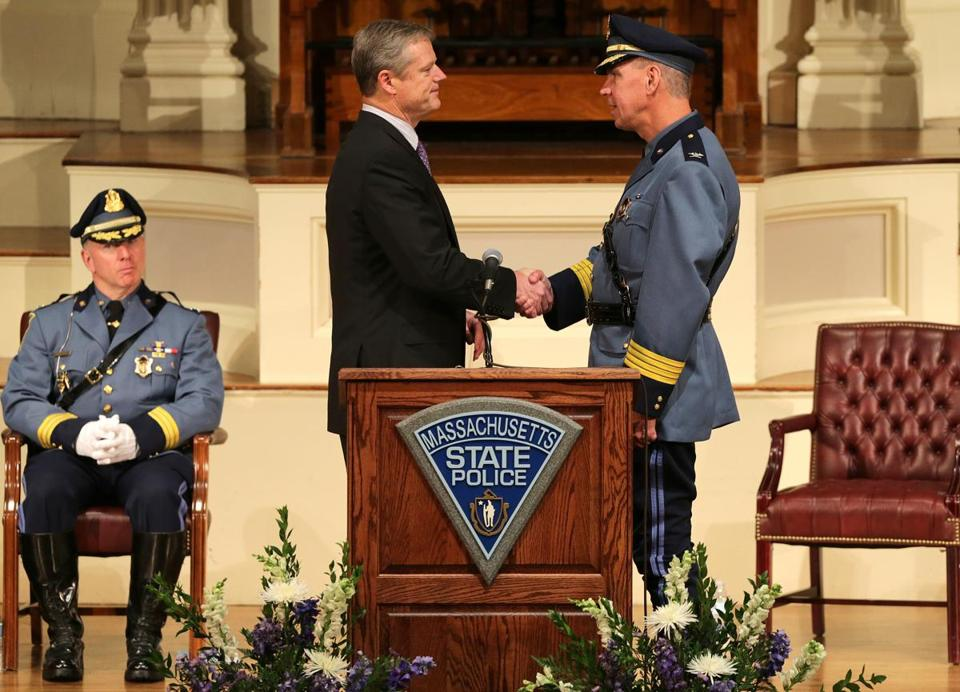 Governor Charlie Baker congratulates Richard D. McKeon, the new superintendent of the Massachusetts State Police, after he was sworn in during a ceremony at Mechanics Hall in Worcester.