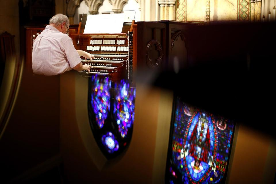 Doug Marshall played the new digital organ after tuning and adding samples at St. Matthew's Church in Wheeling, W.Va.