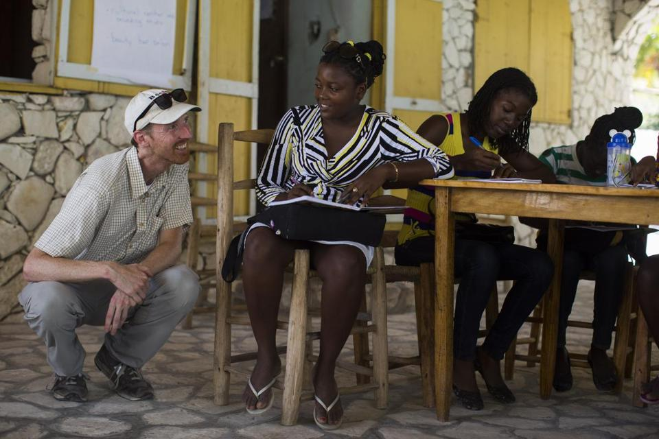 Nathan Eckstrom (left) taught an English class in Les Cayes, Haiti.
