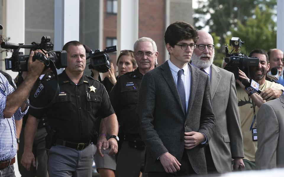Attorney J.W. Carney put his arm around Owen Labrie, who wept when the verdict was announced.