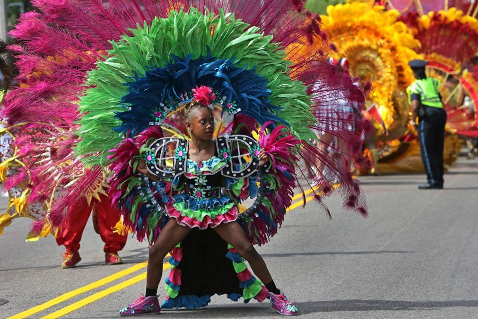 Participants danced in Boston's annual Carnival Day parade on Saturday.
