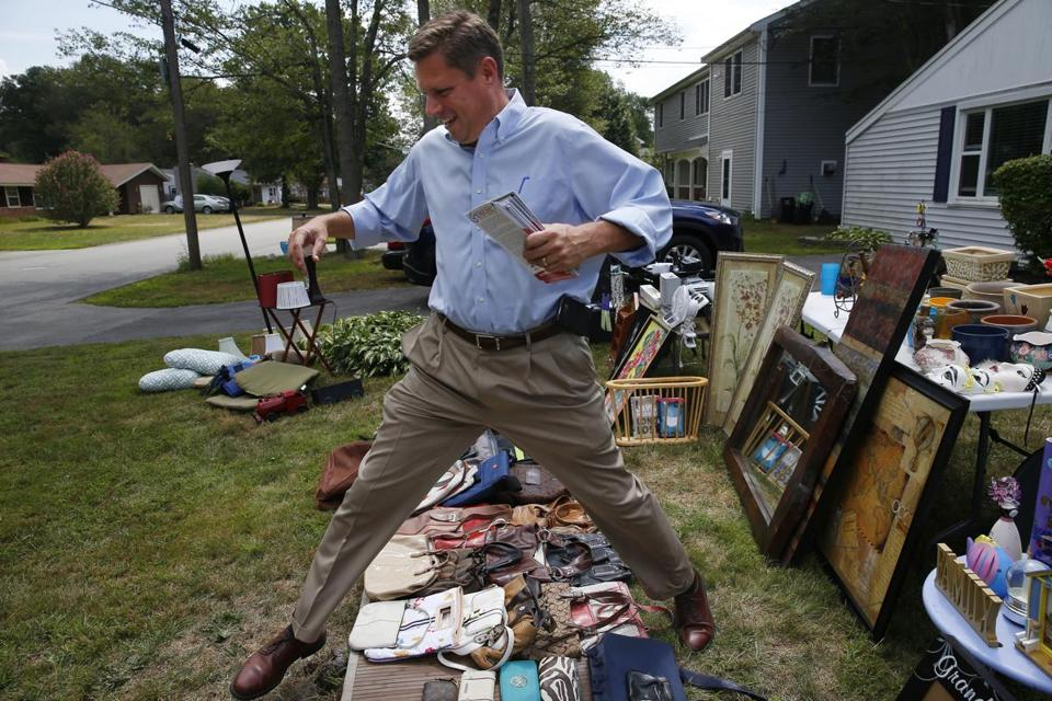 Geoffrey Diehl jumped over items that are part of a yard sale as he campaigned for State Senator in Brockton.
