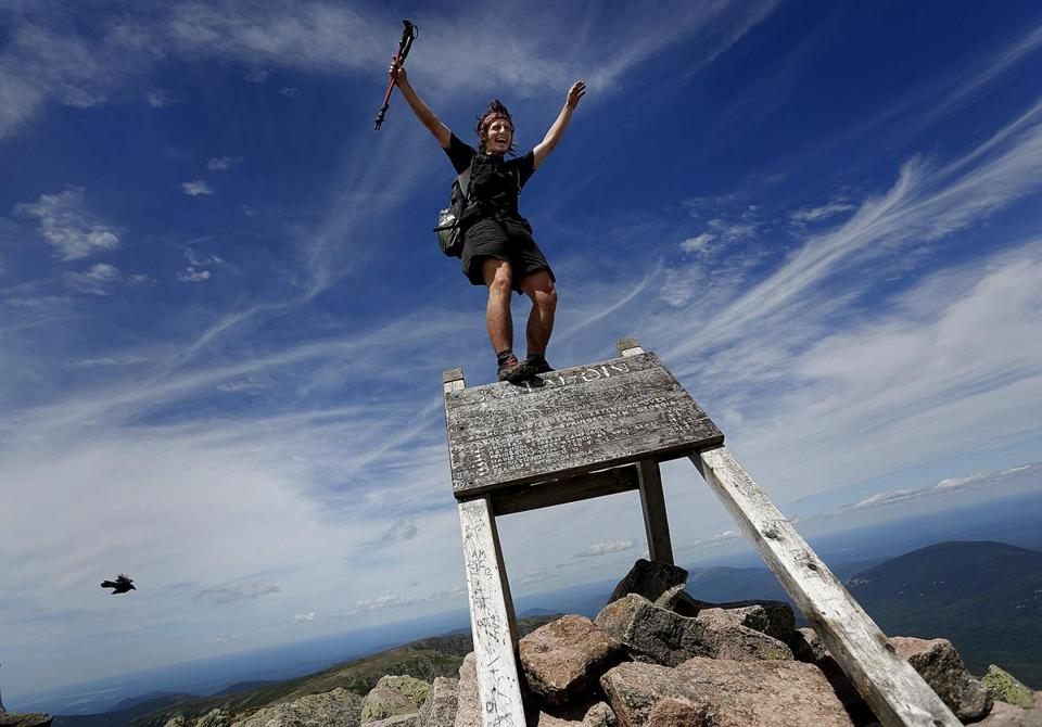 "Jesse Metzler, 19, of Newton, Mass., who goes by the trail name ""Sputnik,"" celebrated at the Appalachian Trail summit of Mount Katahdin in Baxter State Park, Maine."