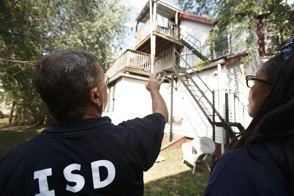 Inspectional Services chief William Christopher and spokeswoman Lisa Timberlake examined a dwelling on Chester Street in Allston where inspectors found more than 30 violations on Sunday.