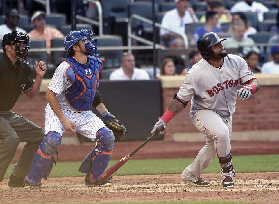 Mets catcher Travis d'Arnaud and Pablo Sandoval watched the flight of the third baseman's sixth-inning double off Jacob deGrom.