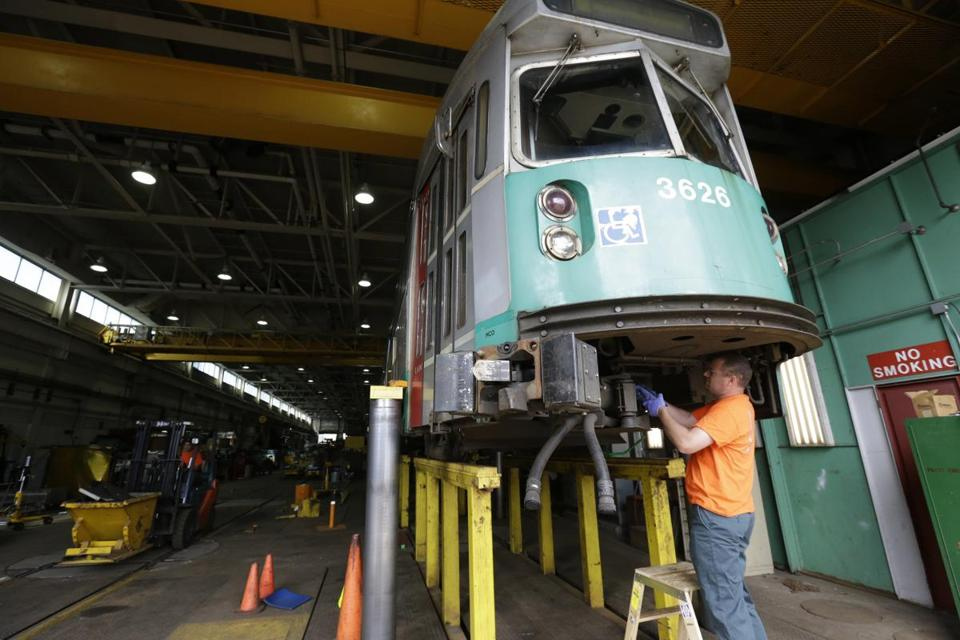 Rob Cunningham  worked on the coupling of a railcar at the MBTA's Riverside maintenance facility in Newton.