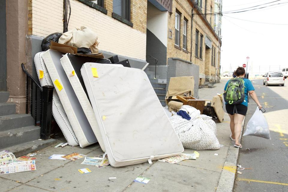 Old mattresses were propped up against a building on Linden Street in Allston.