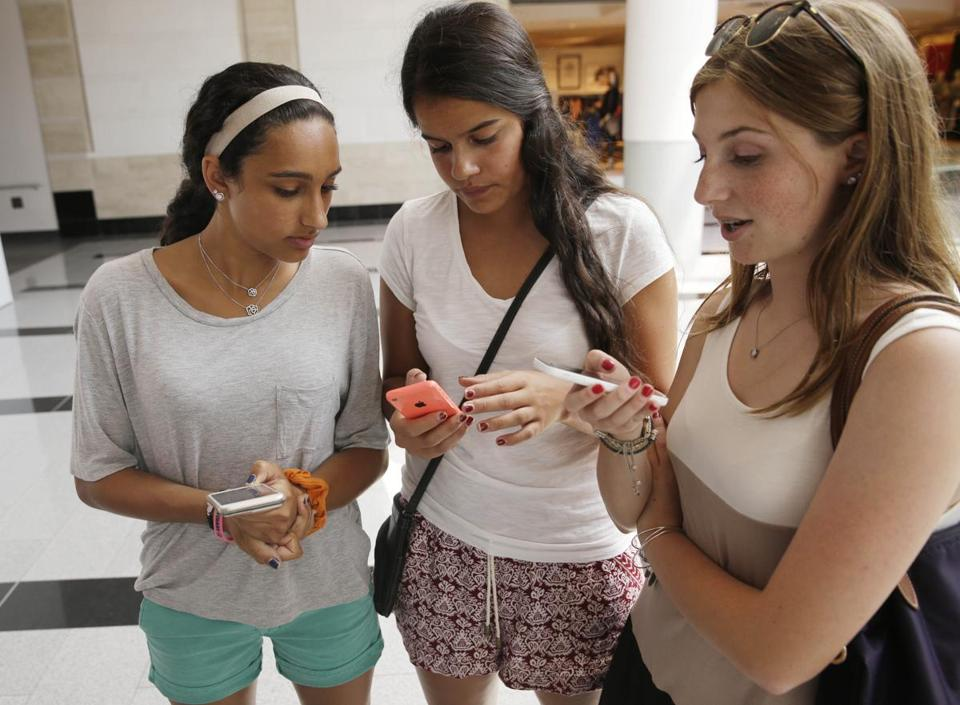 Isabella Cimato, 17, Arianna Schaden, 14, and Sofia Harrison, 15, checked their phones at Roosevelt Field shopping mall in Garden City, N.Y., as they did some back-to-school shopping.