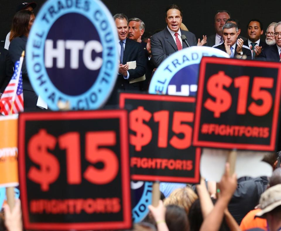 Governor Andrew Cuomo of New York attends a rally of activists calling for higher wages in the fast food industry in Manhattan in June.