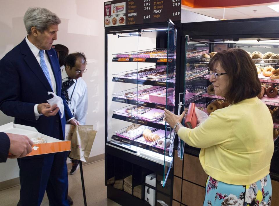 Secretary of State John Kerry went down Friday morning to a new Dunkin' Donuts inside the State Department. He was joined by his office manager, Natick-native Claire Coleman (at right).