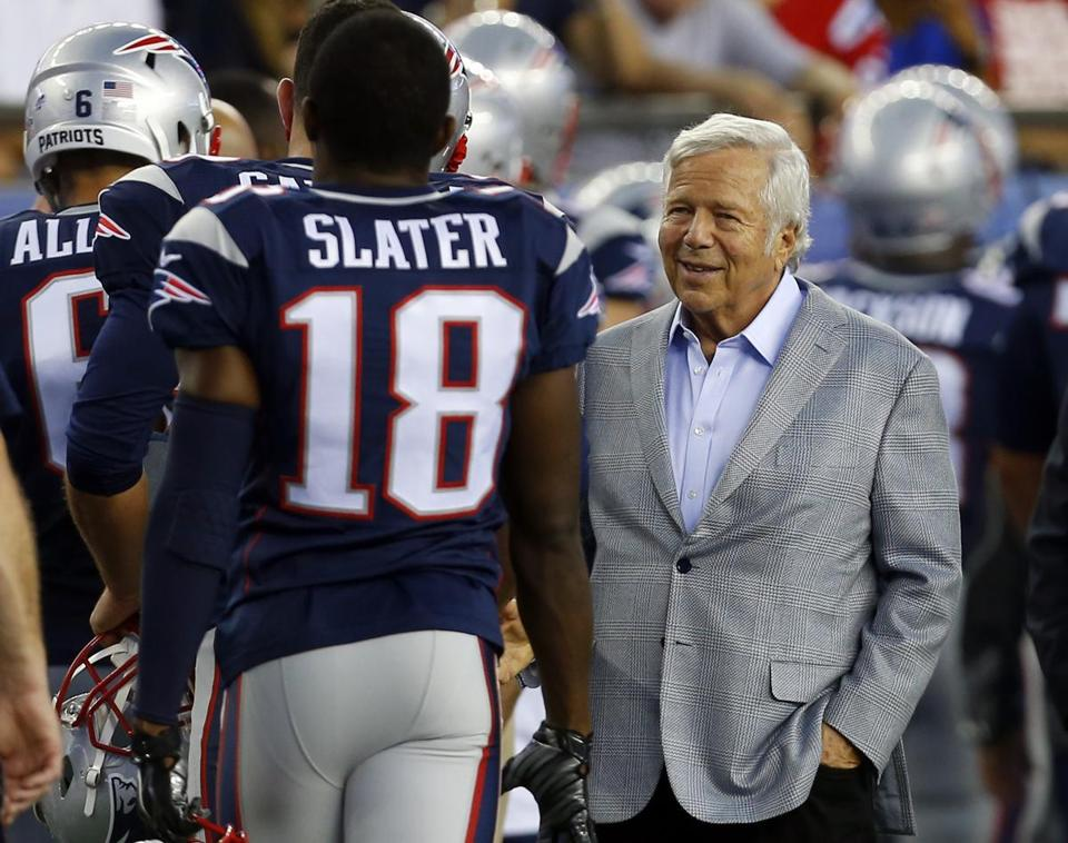 Patriots owner Bob Kraft shook hands with players before the start of a preseason game last year.